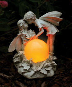 E-V Kissing Solar Fairies Antique Ivory